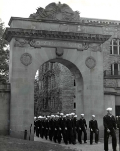 Newly mustered Brown students march through Soldier's Arch on their way to fight in World War II.  The arch is a memorial to their departed fellows from the First World War.